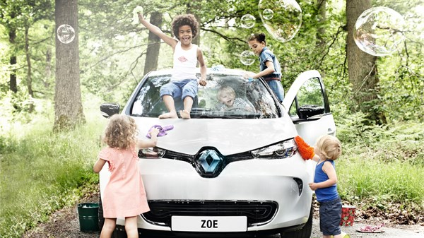 Kids playing with Renault ZOE electric car